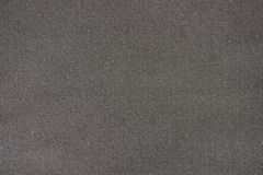 Coarse grain black cloth background Royalty Free Stock Images
