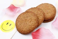 Coarse grain crackers. ,smile card Petal on white background Royalty Free Stock Photos