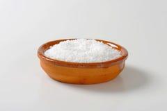 Coarse grained salt. In terracotta bowl Stock Images
