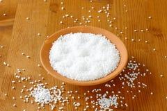 Coarse grained salt. In terracotta bowl Stock Photos