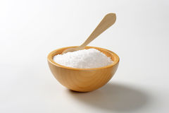 Coarse grained salt. In wooden bowl stock images