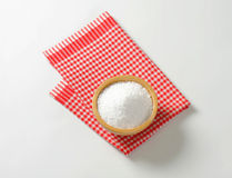 Coarse grained salt. In wooden bowl Stock Photo