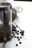 Coarse ground coffee bean in clear French press mug Stock Photo