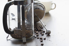 Coarse ground coffee bean in clear French press mug Royalty Free Stock Photos