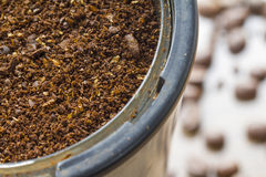 Coarse ground coffee. Bean in a coffee grinder Stock Images