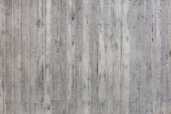 Coarse made, gray wall of exposed concrete Stock Photos