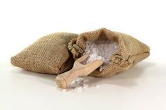 Coarse salt. Grains on a bushel with salt in the bag stock photo