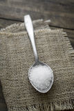 Coarse salt in a large old spoon Royalty Free Stock Images