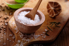 Coarse salt. In small wooden bowl stock photo