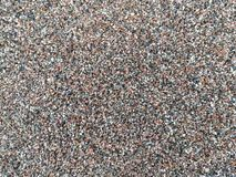 Coarse sand background. Large and small stones. Background. stock image