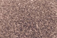 Granite Background in Sepia Tone. A coarse texture in this granite stone can make for a great backdrop or slide for a presentation Stock Photo