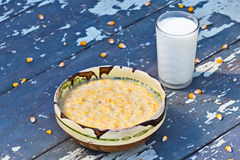 Coarsely ground maize with milk Stock Photos
