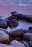 Coast. Landscape in purple evening light Stock Photos