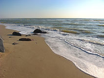 Coast. Waves rolled on sandy shore of the Azov Sea Royalty Free Stock Photos