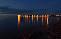 Coast. Seaside. Coast at night in Skerries, Ireland. City skyline at background. Long exposure Stock Photography