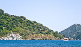 Coast of the Aegean sea. Seascape, view of the beach from the board ships royalty free stock image