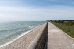 Free Coast And Breakwater Wave Protection Dike On Ile De Ré In France With The Path Royalty Free Stock Photos - 149558518