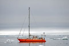 Vessel of the Arctic expedition in the waters of the Arctic Ocean. Coast of the Arctic Ocean, Russia - December 14, 2016: Vessel of the Arctic expedition in the stock photo