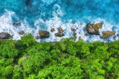 Coast as a background from top view. Turquoise water background from top view. Summer seascape from air. Bali island, Indonesia. royalty free stock photography