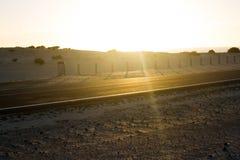 Coast asphalt road. Sunrise on asphalt coat, macro photo of road. Beach way. Highway in Spain. Coast asphalt road. Sunrise on asphalt coat, macro photo of road stock image