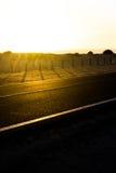 Coast asphalt road. Sunrise on asphalt coat, macro photo of road. Beach way. Highway in Spain. Coast asphalt road. Sunrise on asphalt coat, macro photo of road Royalty Free Stock Photos