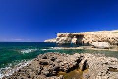 Coast and Azure Window formation on Gozo Stock Photos