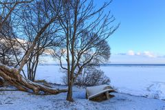 The coast of Baltic sea. Landscape landscape of the Baltic Sea coast in winter with beautiful clouds and blue sky on a sunny day, water and stones, covered with Stock Photos