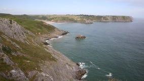 Coast and beach Three Cliff Bay the Gower Peninsula Swansea Wales uk near Oxwich stock video