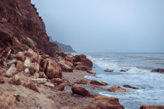 Coast of Black sea early in the morning. With big rock Royalty Free Stock Photo