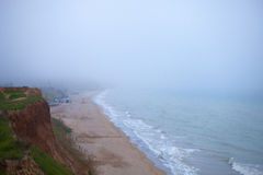 Coast of Black sea early in the morning. In fog Stock Photos