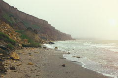 Coast of Black sea early in the morning with fog Royalty Free Stock Image