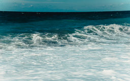 Coast of the Black Sea. Restless Black Sea and blue background of the sky stock images