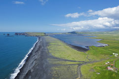 Coast and black volcanic sand, Iceland. View of south coast at Dyrholaey, Iceland Stock Photography