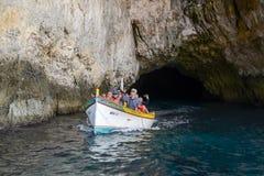 Coast at Blue Grotto in the Malta island. Blue Grotto, Malta - 3 November 2017: tourists visiting the coast by boat at Blue Grotto in the Malta island Stock Photos