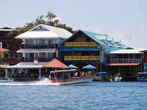 Coast in Bocas Town. Hotels and restaurants with boat in Bocas del Toro stock photo