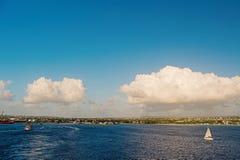 Coast of Bridgetown, Barbados seen from Caribbean sea. Sailing ships in Caribbean sea. Summer vacation on Caribbean. Tropical island. Idyllic seascape on blue stock image