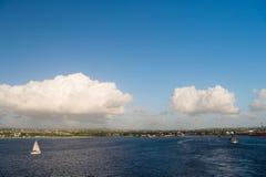 Coast of Bridgetown, Barbados seen from Caribbean sea. Sailing ships in Caribbean sea. Summer vacation on Caribbean. Tropical island. Idyllic seascape on blue royalty free stock image