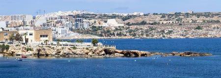 Coast in Bugibba, Malta. Rocky coast in Bugibba tourist city, Malta, Europe Royalty Free Stock Photography
