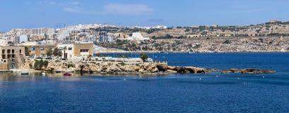 Coast in Bugibba, Malta. Rocky coast in Bugibba tourist city, Malta, Europe Stock Photo