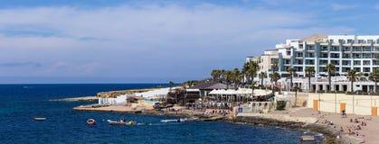 Coast in Bugibba, Malta. Rocky coast in Bugibba tourist city, Malta, Europe Royalty Free Stock Images