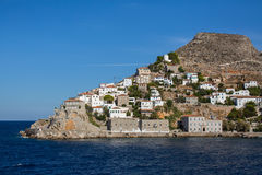 Coast with buildings and the entrance to the Marina on the Hydra island Royalty Free Stock Photos