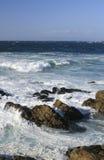Coast of California: rocks, ocean and blue sky. Coast of California, Monterey bay: rocks, ocean with waves and blue sky Stock Image