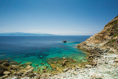 The coast of Cap Corse at Canelle in Corsica. With the Desert des Agriates in the background royalty free stock photos