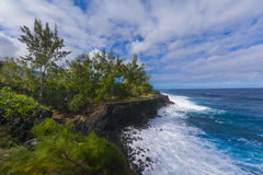 Coast of Cap Mechant place at Reunion Island. During a sunny day Stock Photo