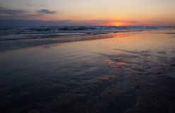 The coast of the Caspian Sea at sunrise. Nature royalty free stock photography