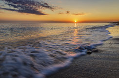 The coast of the Caspian Sea at sunset. Nature stock image