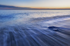 The coast of the Caspian Sea at sunset. Nature stock photography