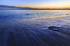 The coast of the Caspian Sea at sunset. Nature royalty free stock photos