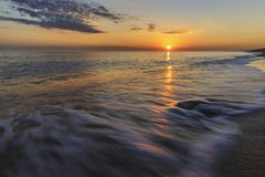 The coast of the Caspian Sea at sunset. Nature royalty free stock photography