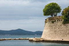 Coast and city walls. Zadar. Croatia. Stock Photography